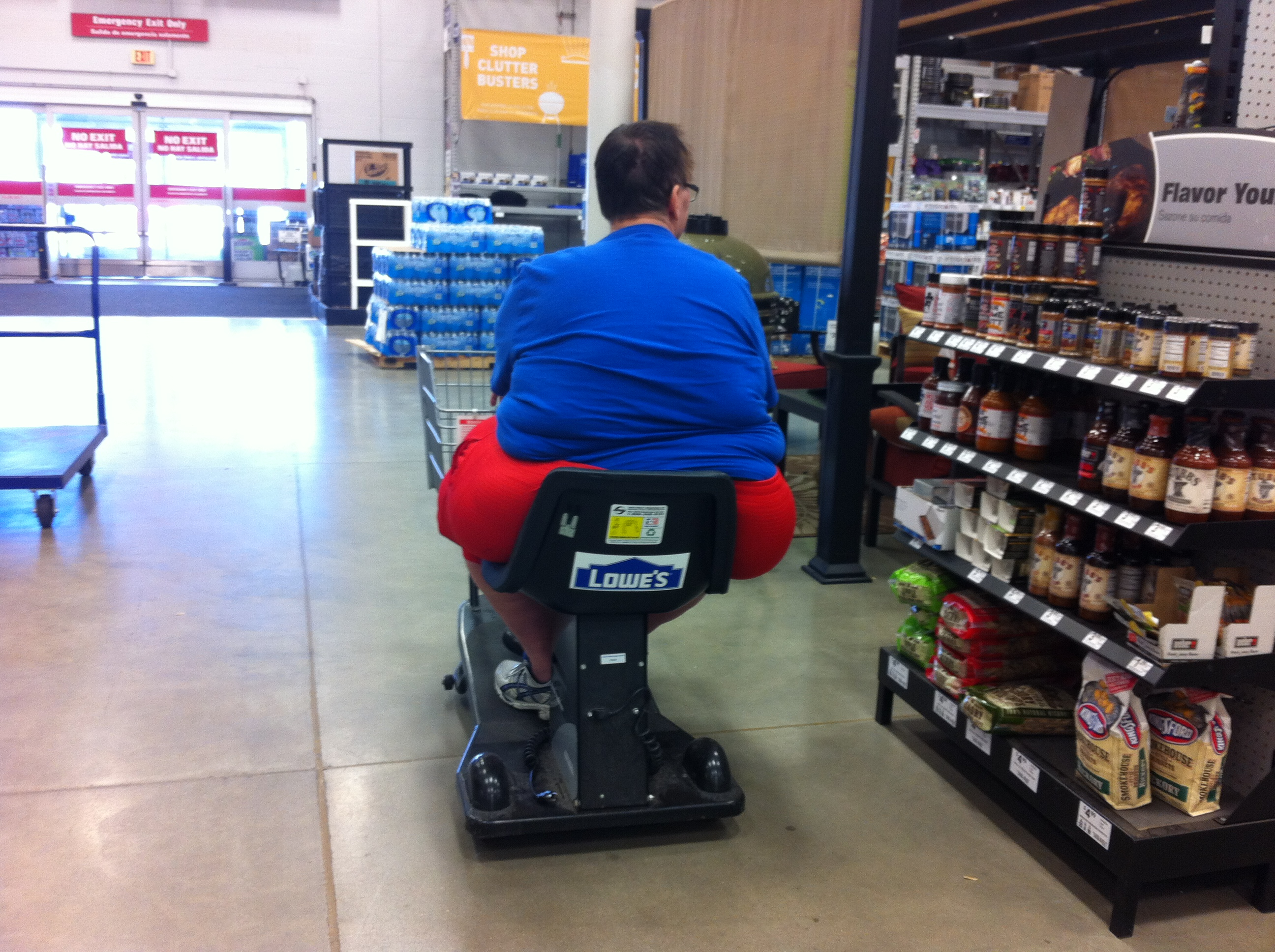 File obese man in motorized cart at lowe 39 wikimedia for Motorized cart for seniors