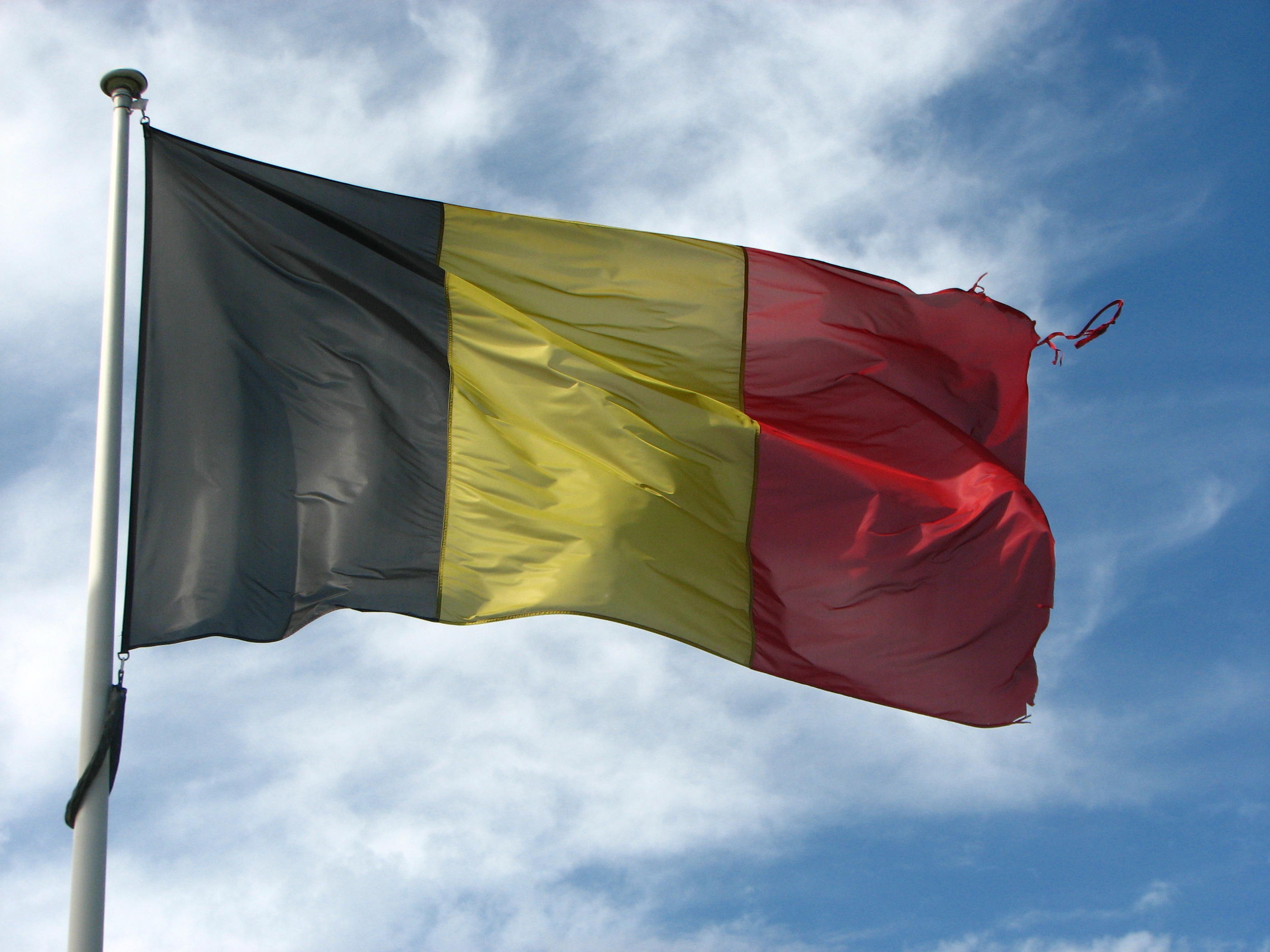 Old Frayed Belgian Flag (6032138651).jpg