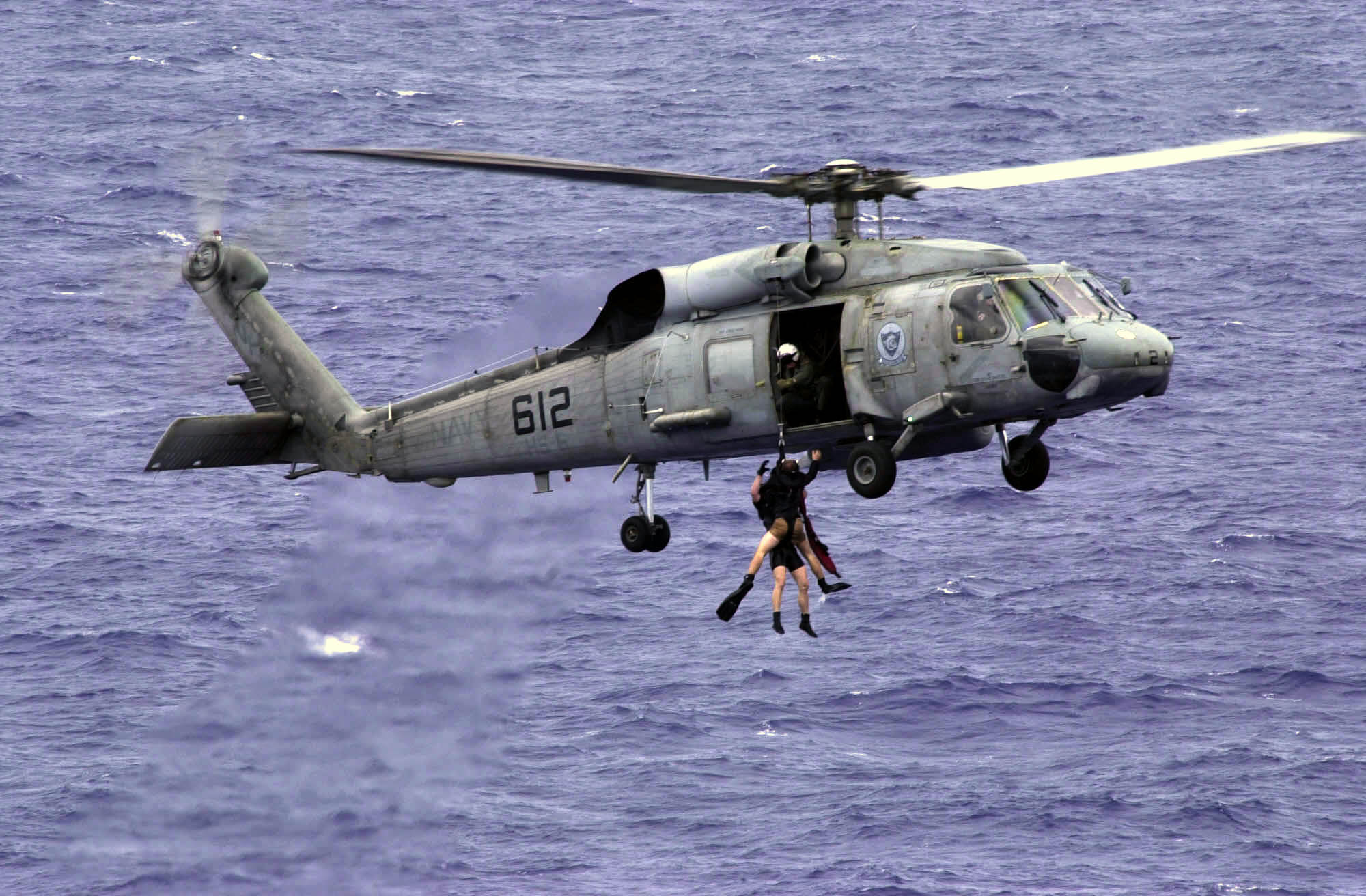 US_Navy_031017-N-1577S-003_An_SH-60F_Seahawk_assigned_to_the_Indians_of_Helicopter_Anti-Submarine_Squadron_Six_%28HS-6%29_recover_Search_and_Rescue_%28SAR%29_swimmers.jpg