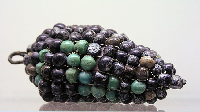 Ancient Egyptian glass and bronze grapes