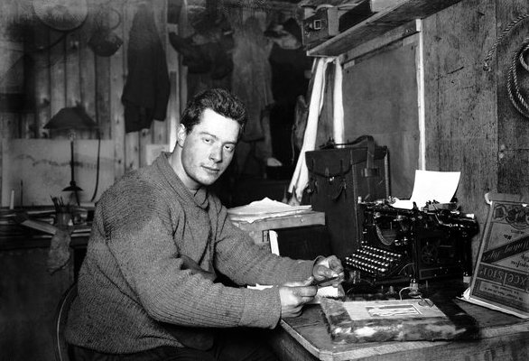 Wikipedia caption: Polar explorer Apsley Cherry-Garrard in front of his typewriter in the Terra Nova hut at Cape Evans (Ross Island, Antarctica). August 30, 1911. British Antarctic Expedition 1910-13 (Ponting Collection)