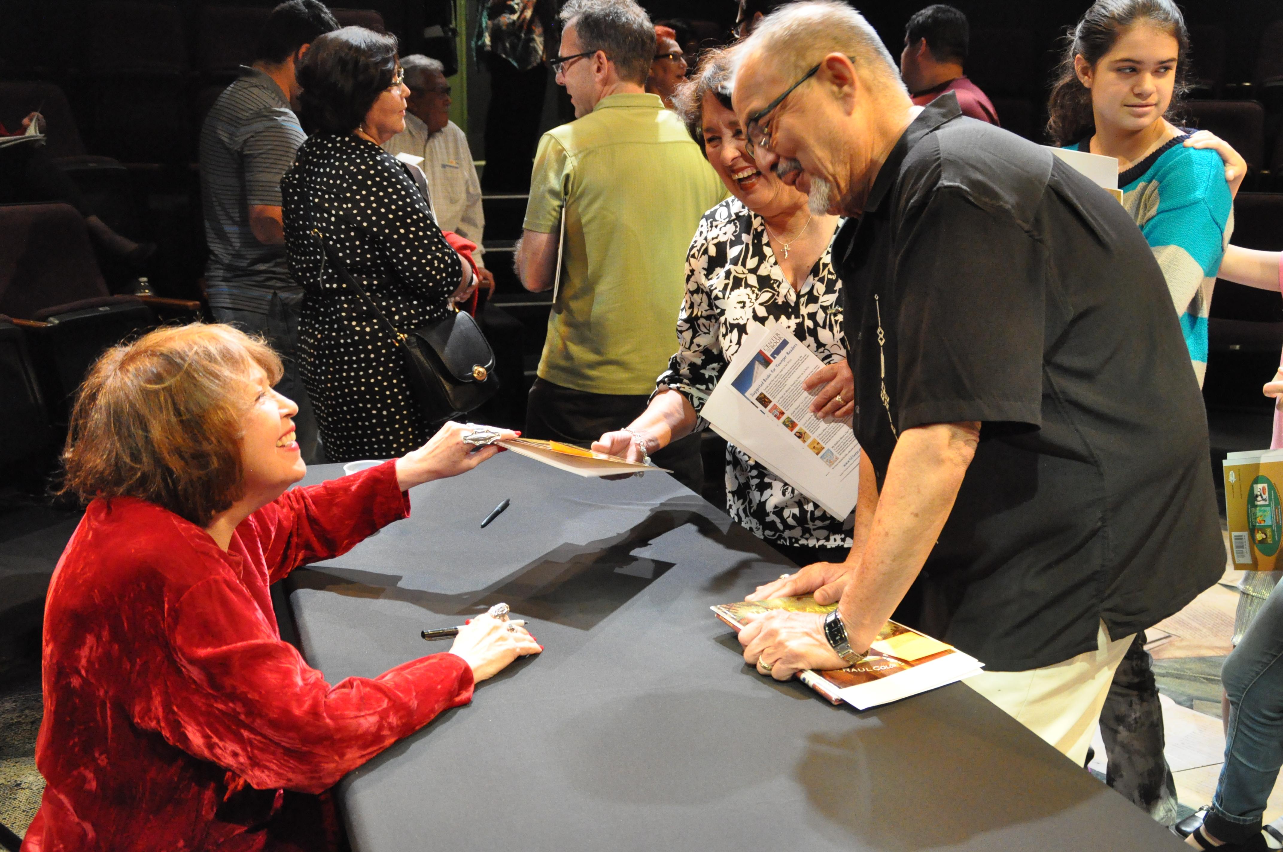 Mora at a book signing in 2015