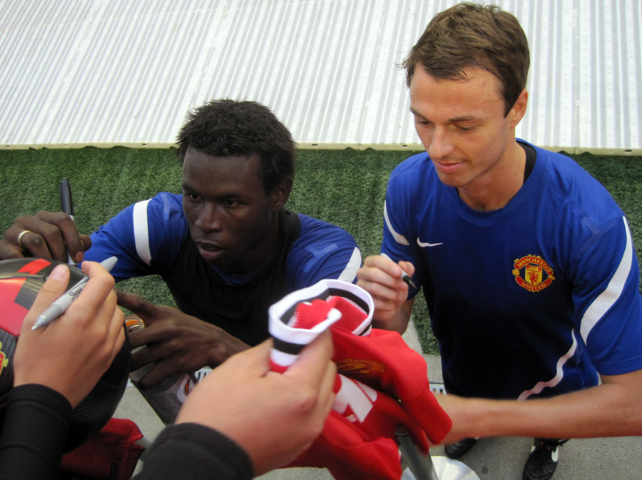 Evans signing autographs