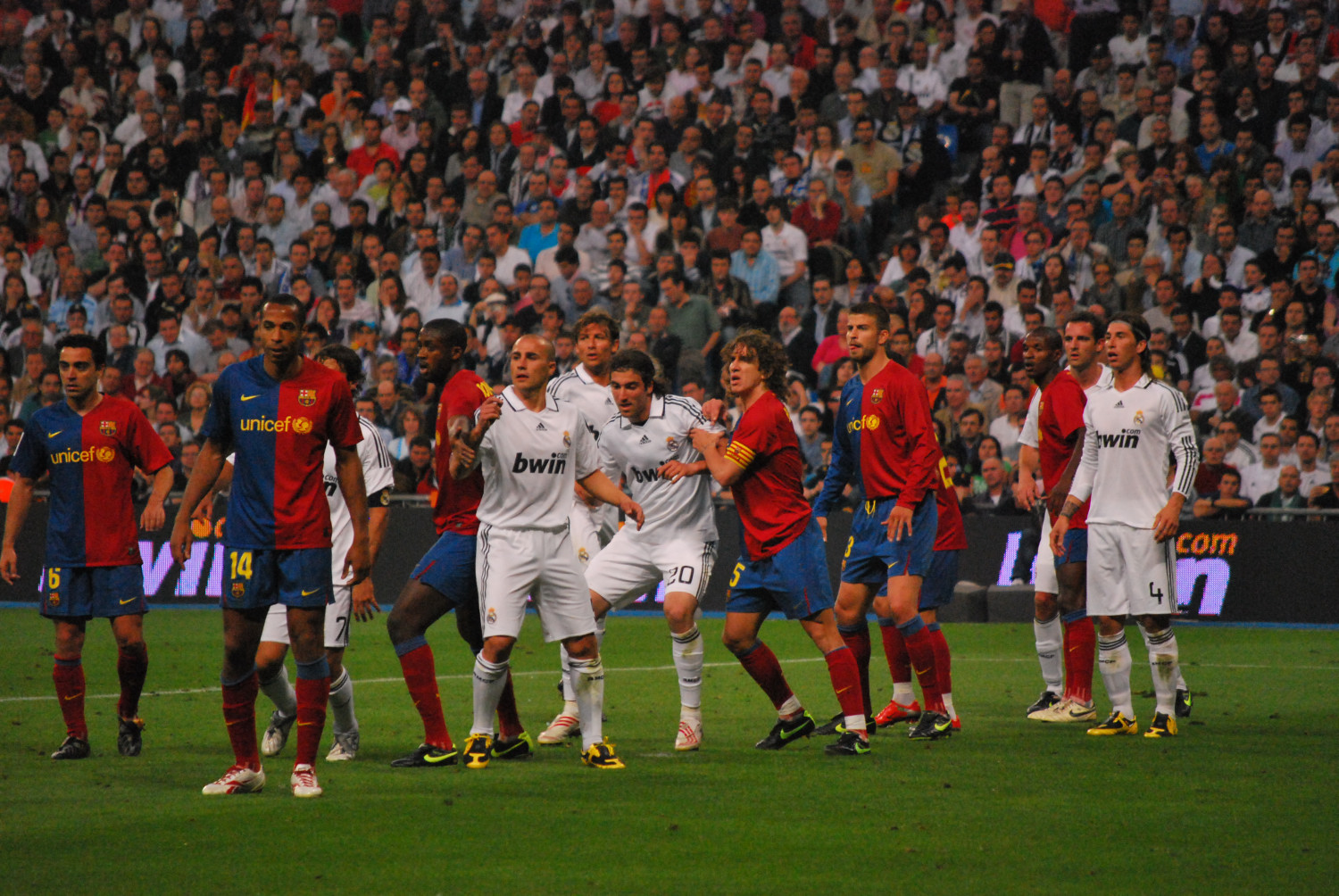 e9094db8d77 Players jostle in Barcelona's 2–6 win against Real Madrid at the Santiago  Bernabéu Stadium in a 2009 El Clásico.