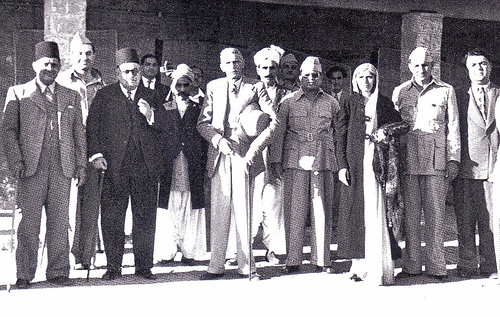 M.A. Jinnah (middle) and Fatima Jinnah (3rd right), stands with the Muslim philosophers at the convention who presented the Idea of Pakistan, circa before 1947. Jinnah and Muslim League founders.jpg