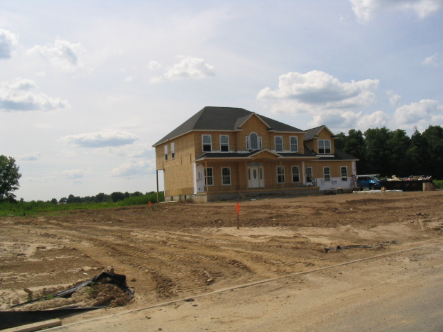 Home under construction. Courtesy Wikimedia Commons.