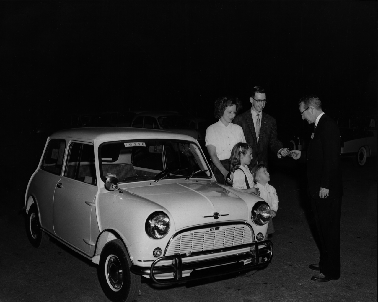 The first Morris Mini-Minor sold in Texas being delivered to a family in Arlington, Texas, in 1959.