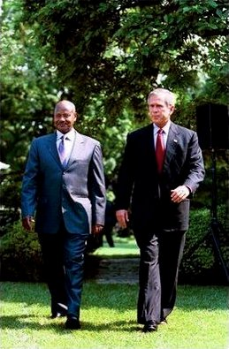two men walking; they're wearing suits.