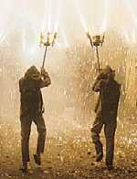 Two dancers of Ball de diables carrying fireworks.