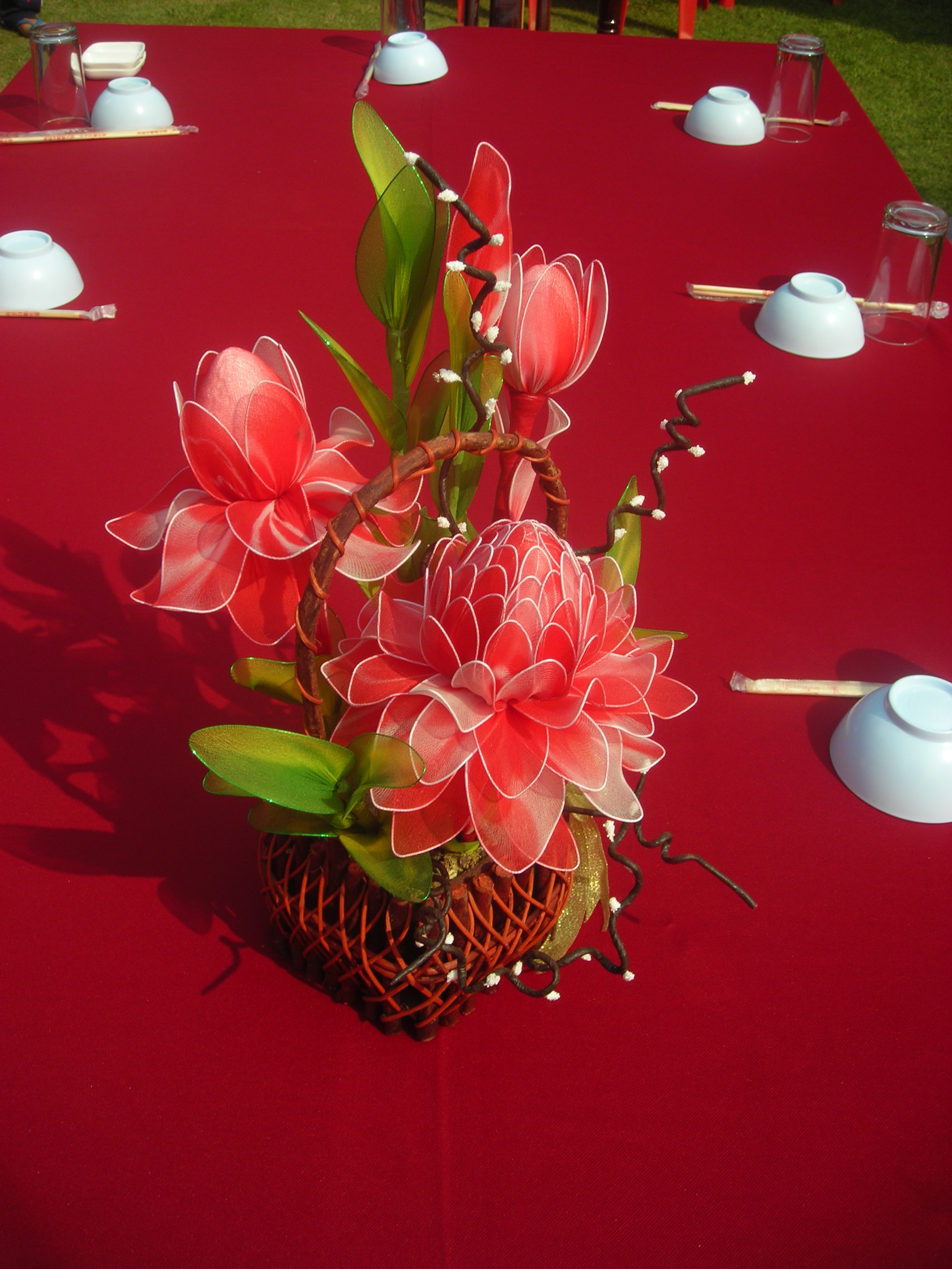 File red artificial flower as table decoration jpg for Artificial flower for decoration