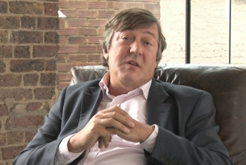 The photo shows Stephen Fry sat in a leather chair