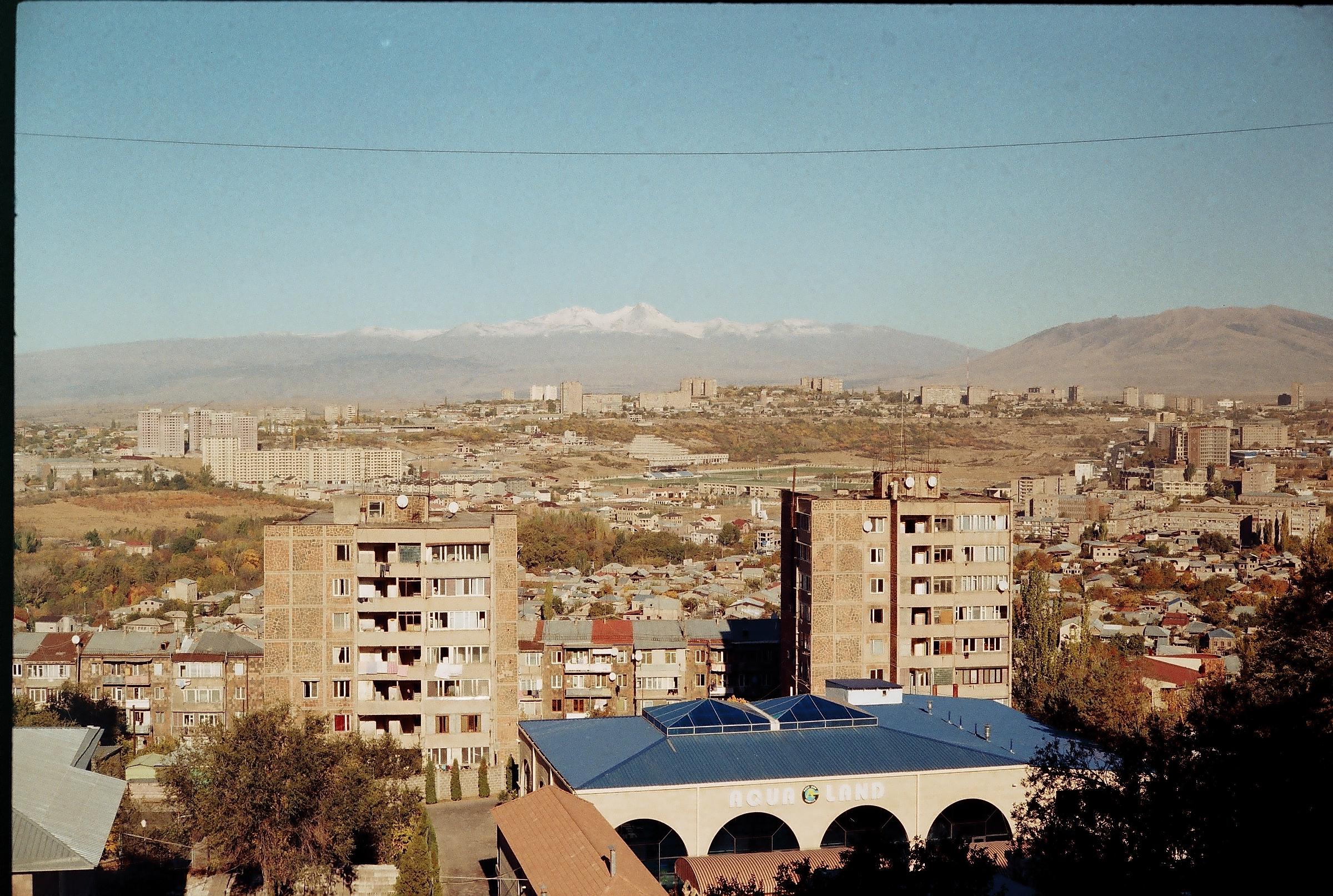 Yerevan on the background of Mounts Aragats and Ara Ler.jpg