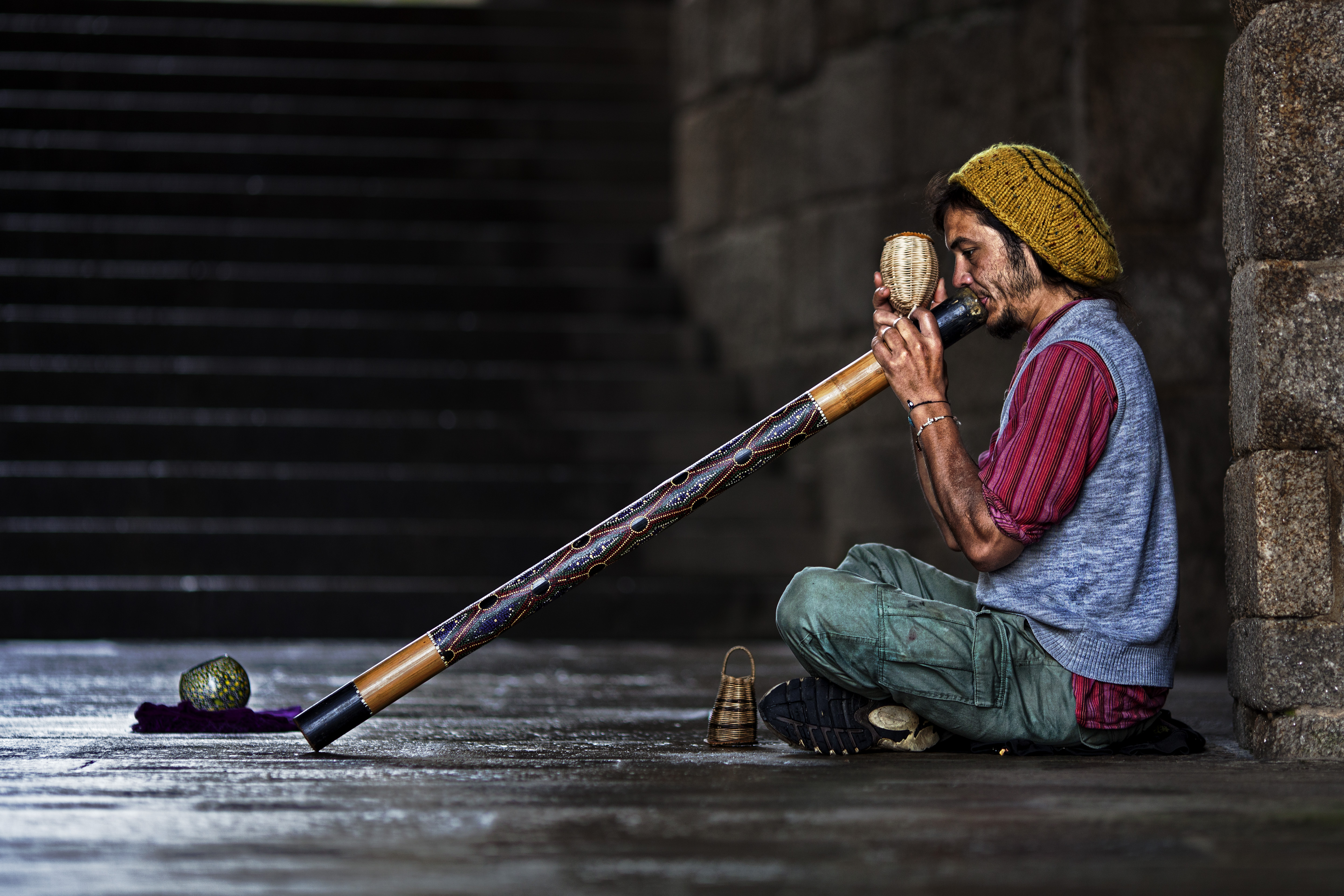 Didgeridoo player entertaining passers by in the street