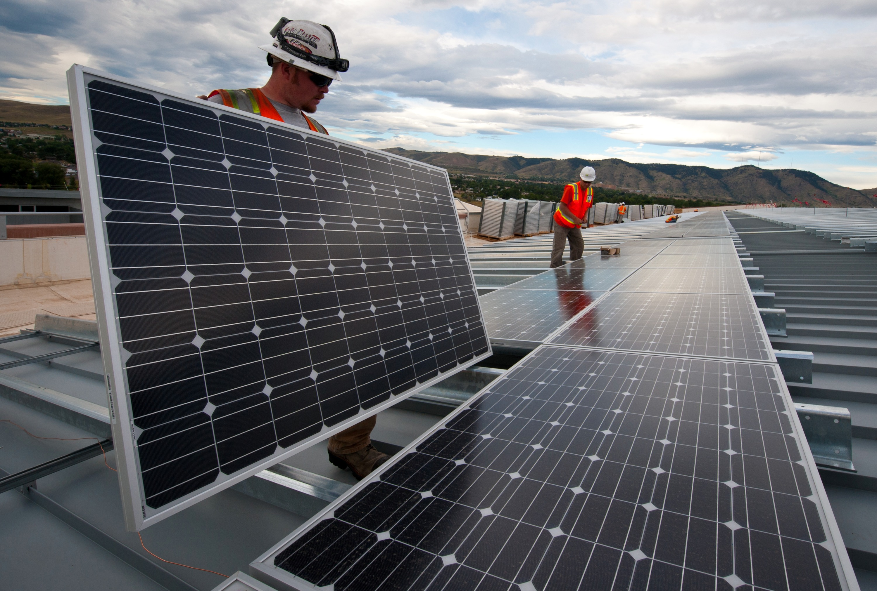 File:Installing Solar Panels (7336033672).jpg - Wikimedia Commons