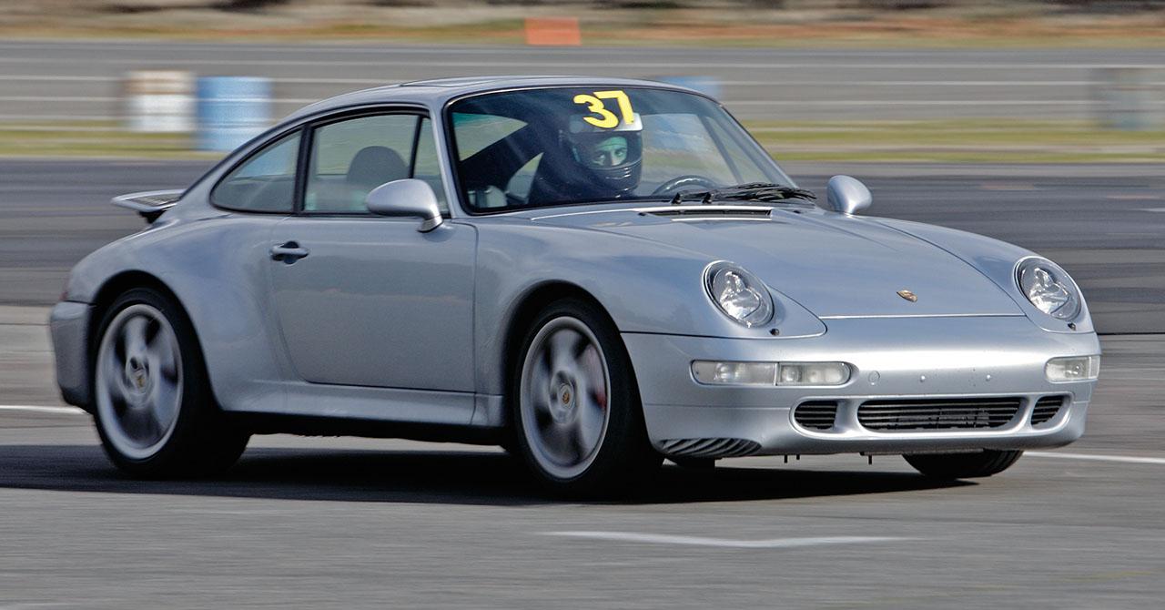 File:Silver Porsche 993 Carrera racing.jpg