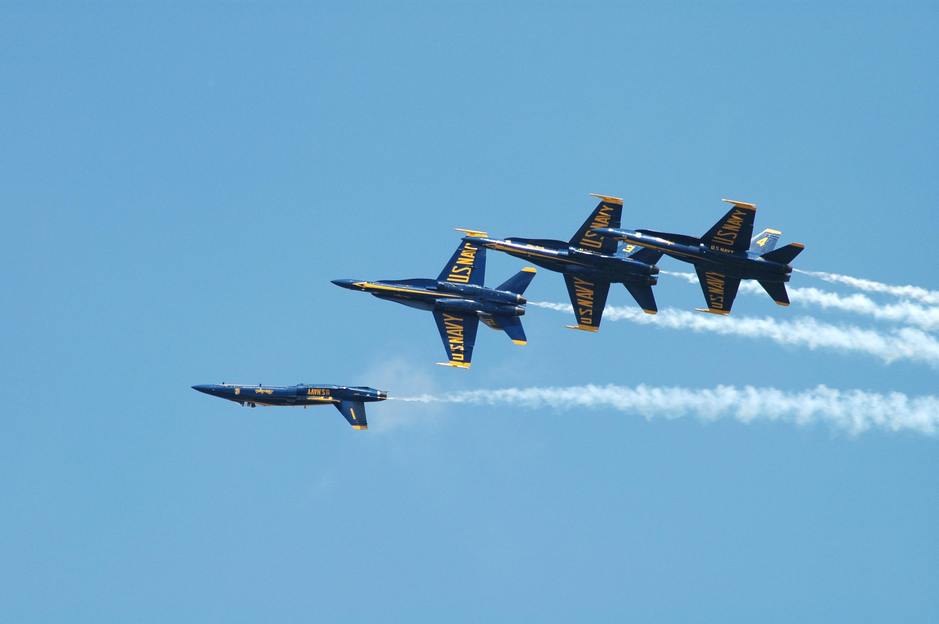 team the blue angels perform a four aircraft break