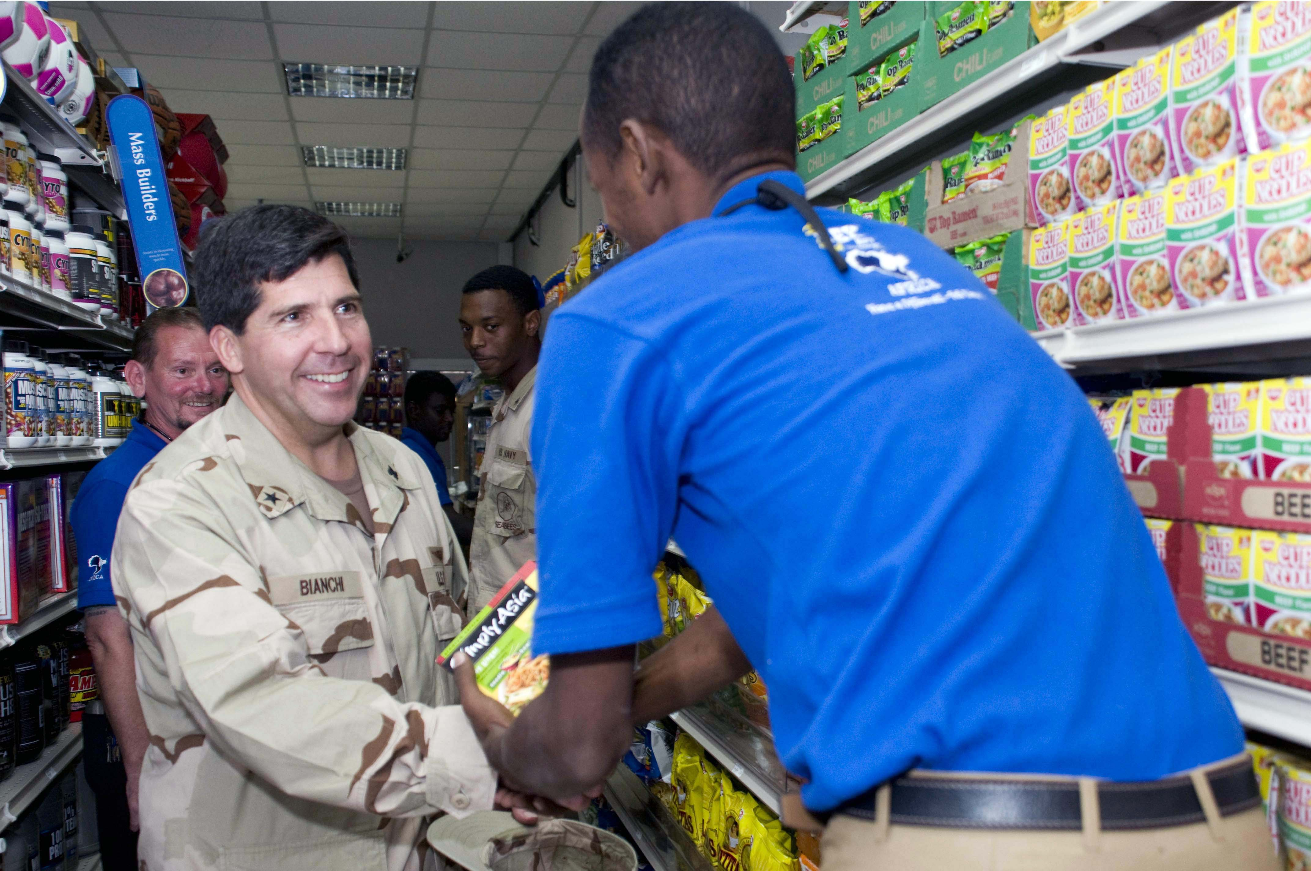 ... Navy Exchange Service Command, greets a local Djiboutian Navy Exchange
