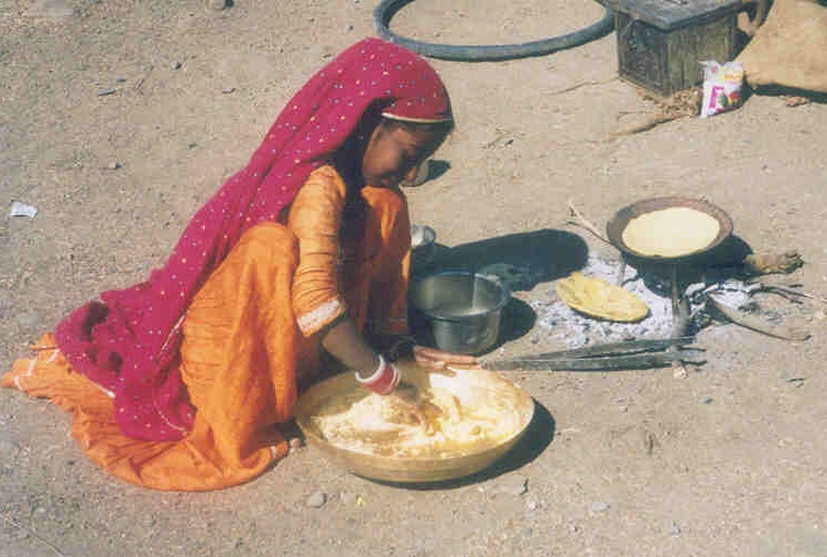 A girl from the Gadia Lohars nomadic tribe of Marwar, cooking her food