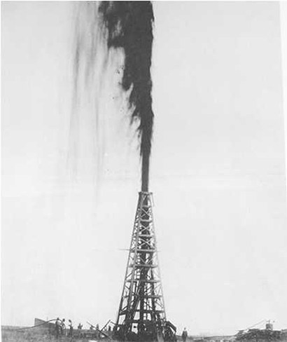 An oil derrick spewing a gusher of crude high into the sky