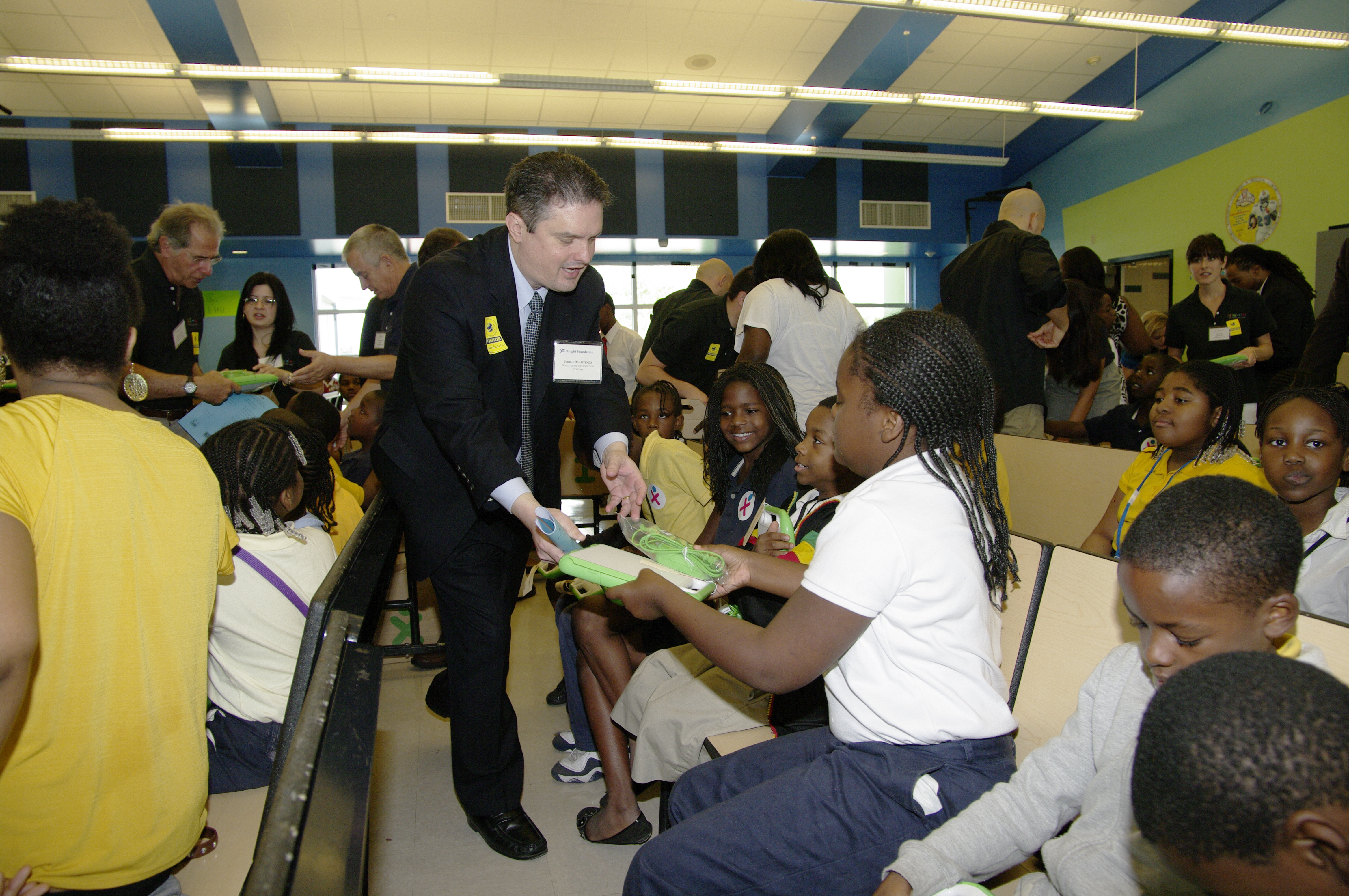 Jorge Martinez, Director of Information Systems for Knight Foundation, gives laptops to kids at Holmes Elementary School, 2012