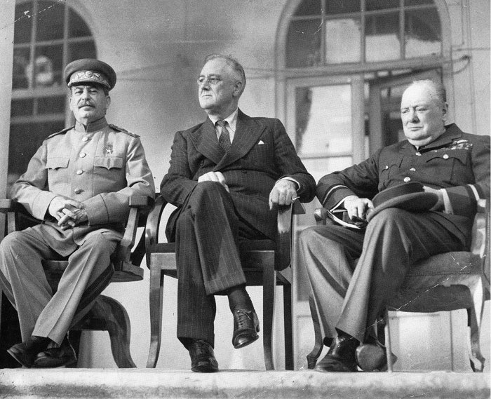 "The ""Big Three"": From left to right: Joseph Stalin, Franklin D. Roosevelt, and Winston Churchill on the portico of the Russian Embassy during the Tehran Conference to discuss the European Theatre in 1943. Churchill is shown in the uniform of a Royal Air Force air commodore."