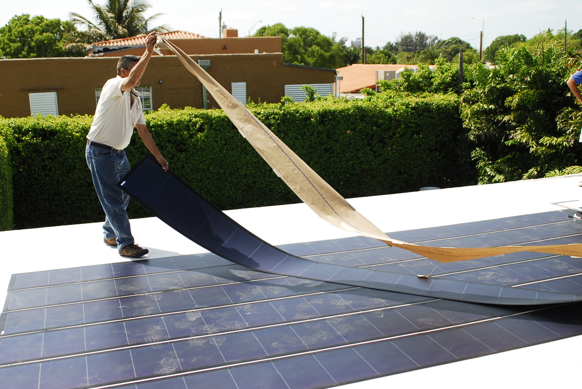 File:Thin Film Flexible Solar PV Installation 2.JPG - Wikipedia, the ...