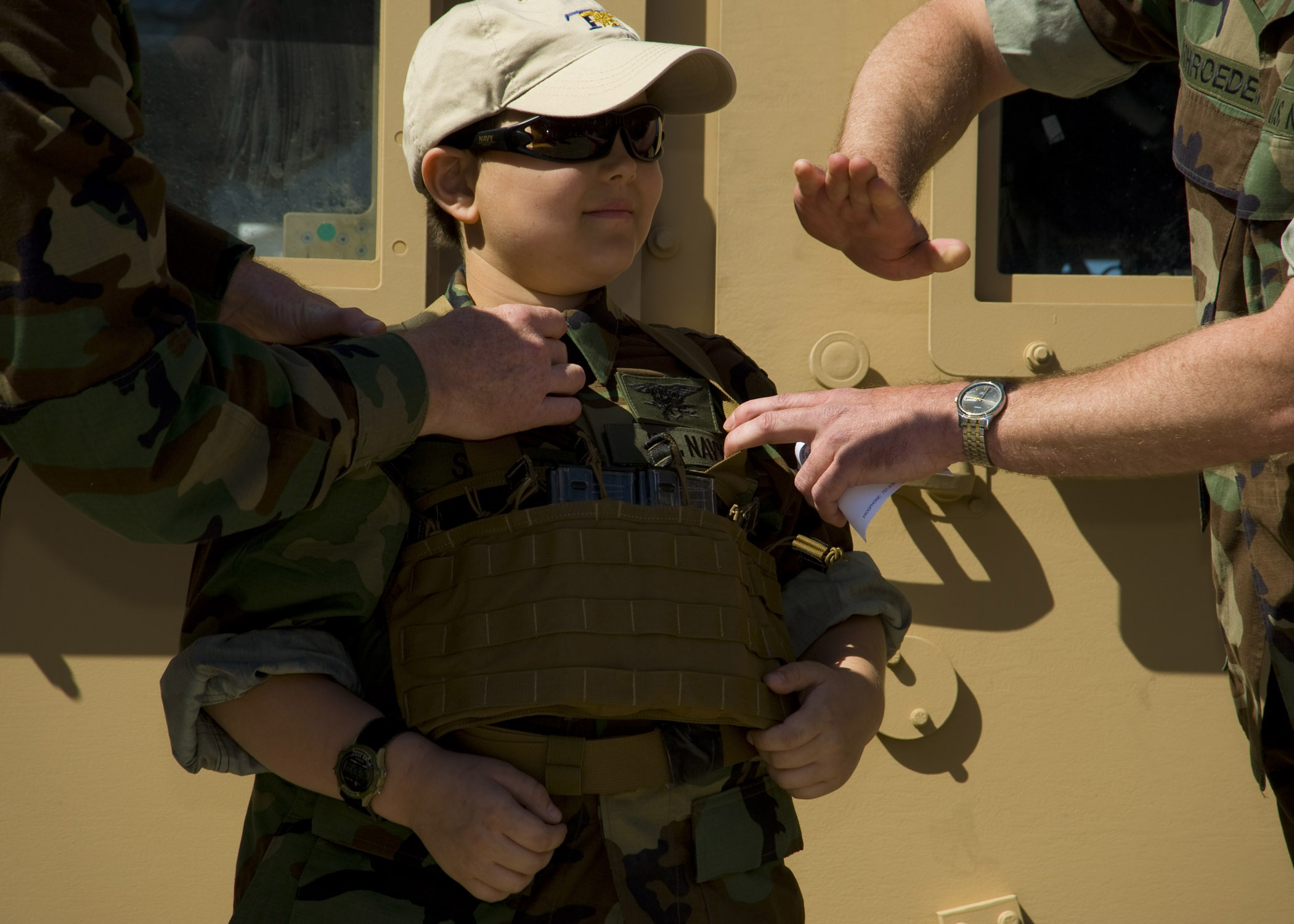 File Two U S Navy Seals Pin A Boy To Signify Him As The Newest Honorary
