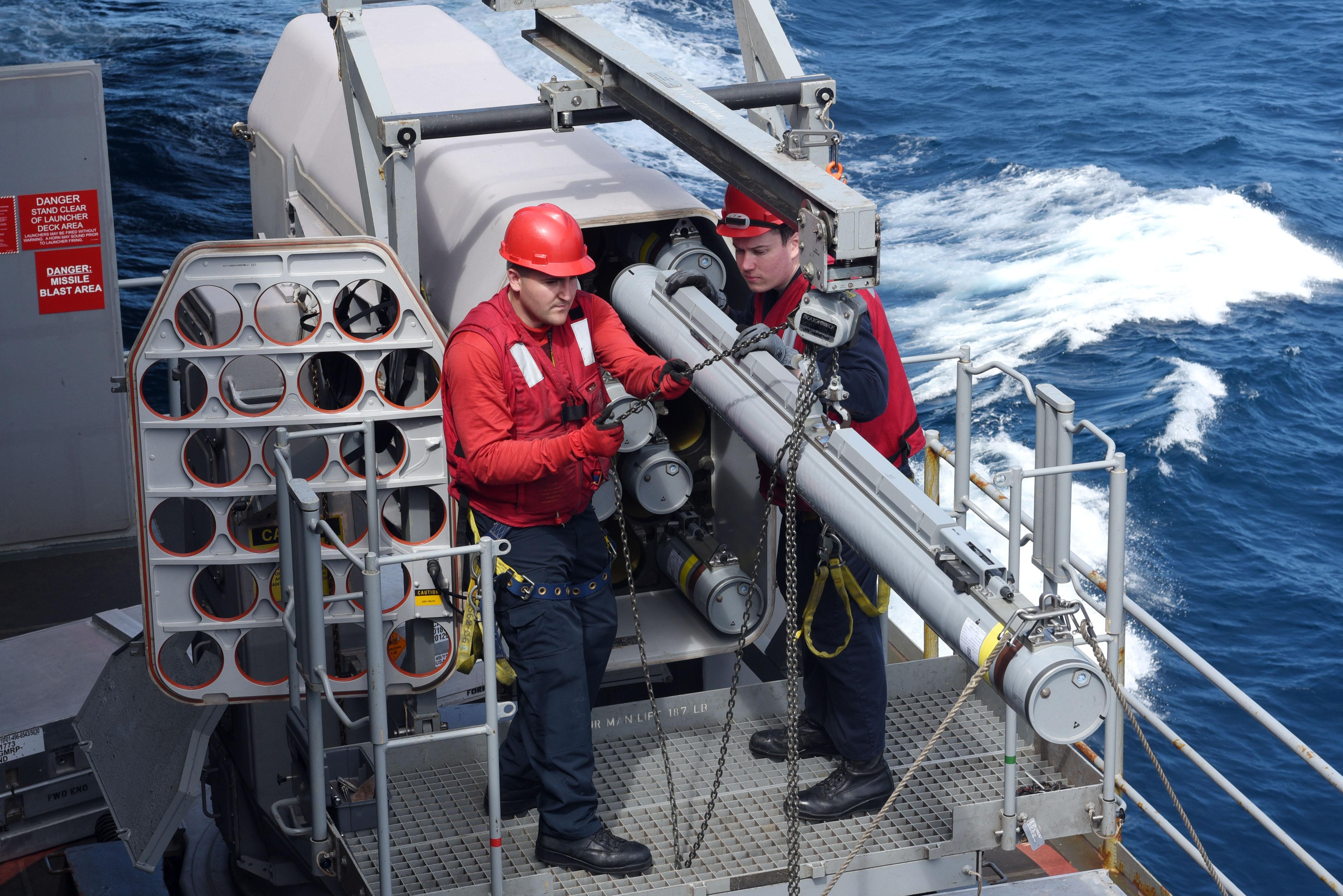 File:USS Harry S  Truman (CVN 75) sailors load a missile into a