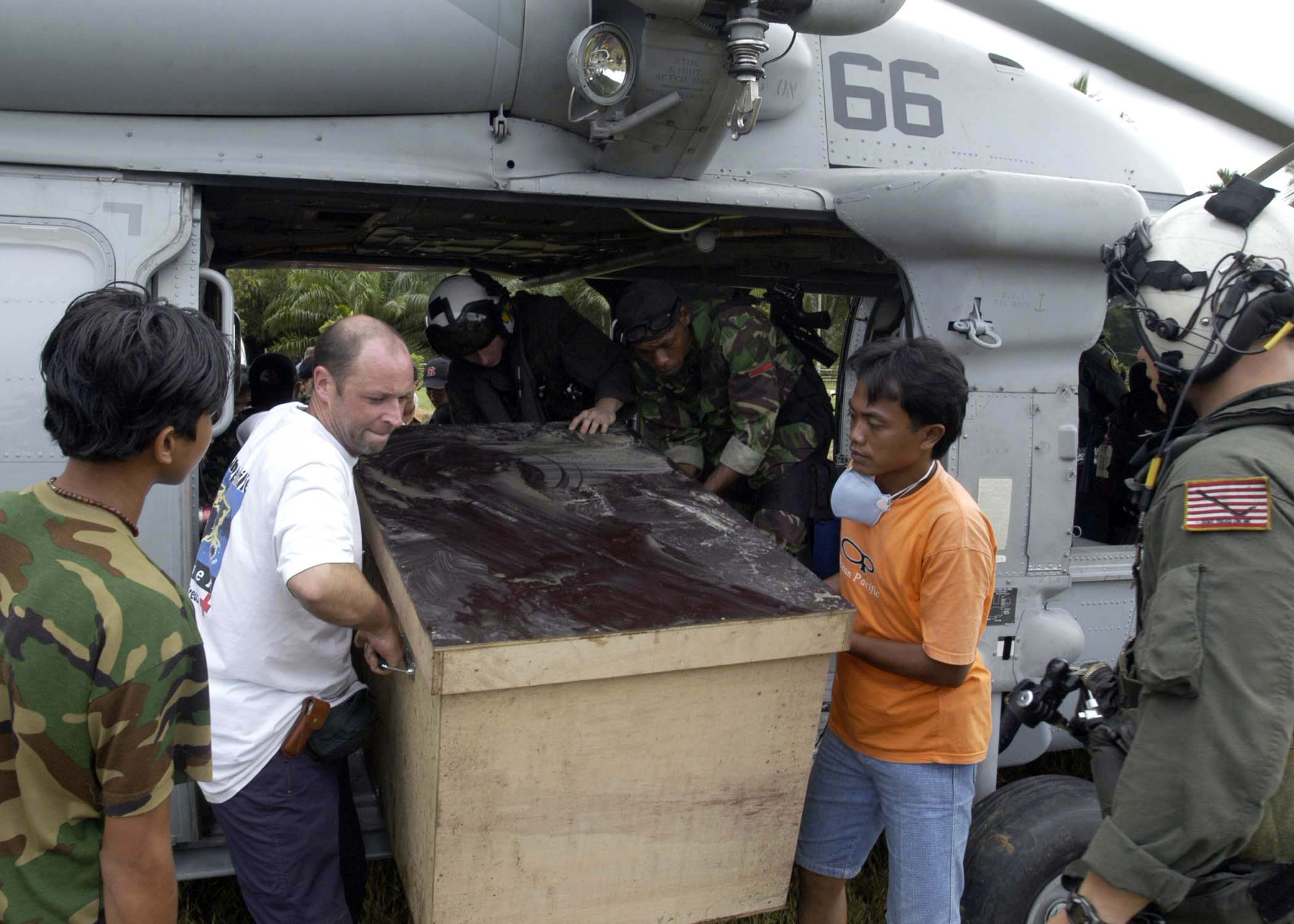 Us navy 050110 n 1229b 130 foreign aid workers and military personnel