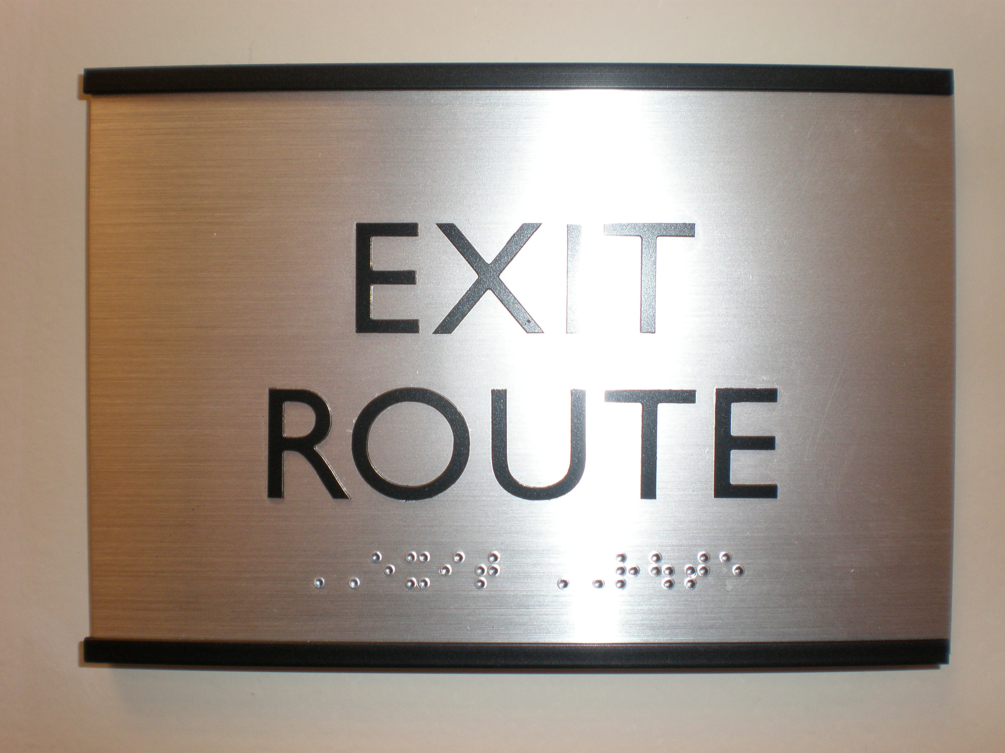 A braille sign description for an exit sign.