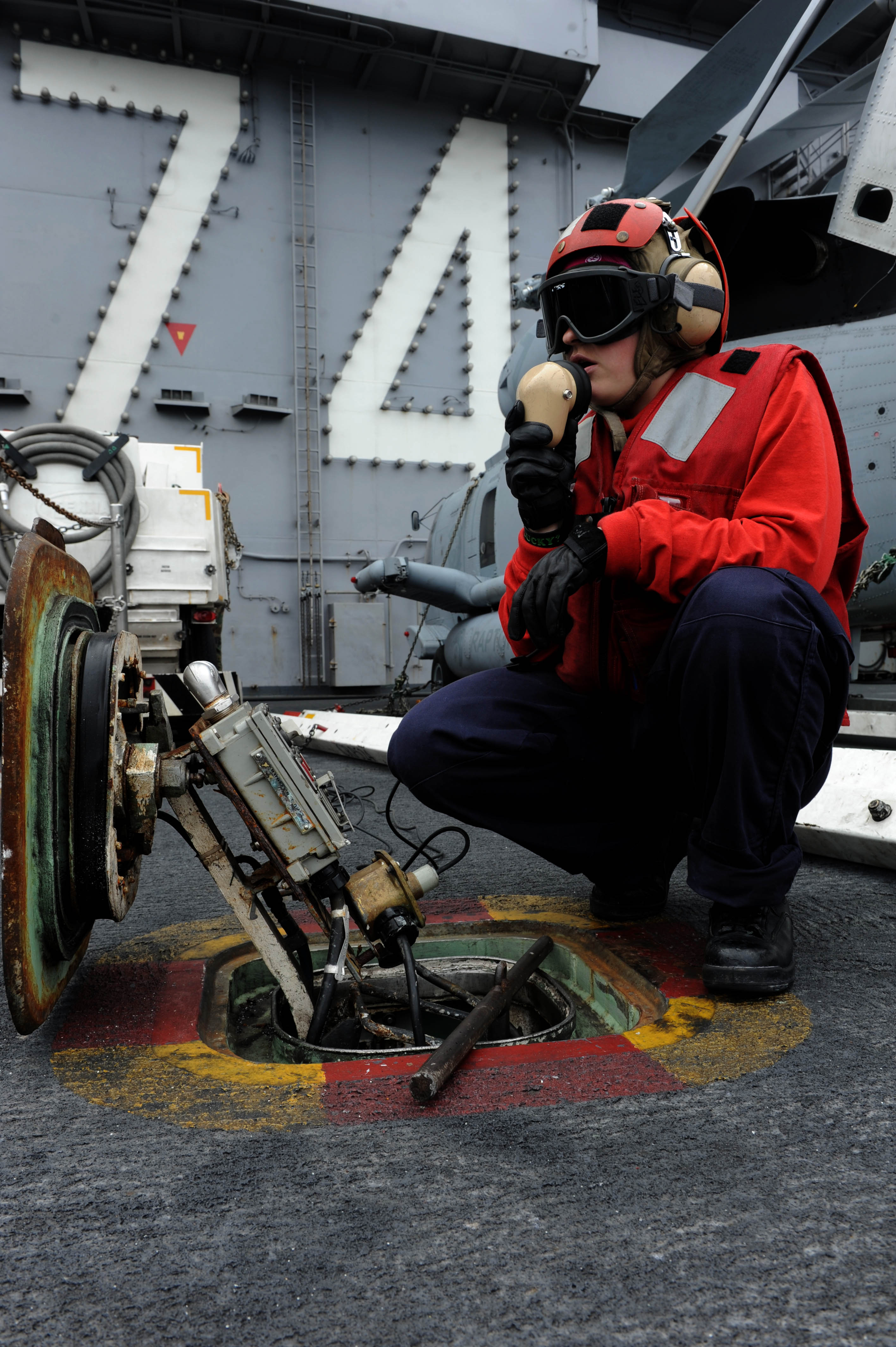 on the flight deck aboard the Nimitz-class aircraft carrier USS John C. Stennis (CVN 74). John C. Stennis is participating in a composite training unit