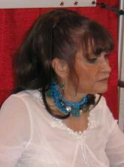 http://upload.wikimedia.org/wikipedia/commons/d/d9/Margot_Kidder_cropped.JPG