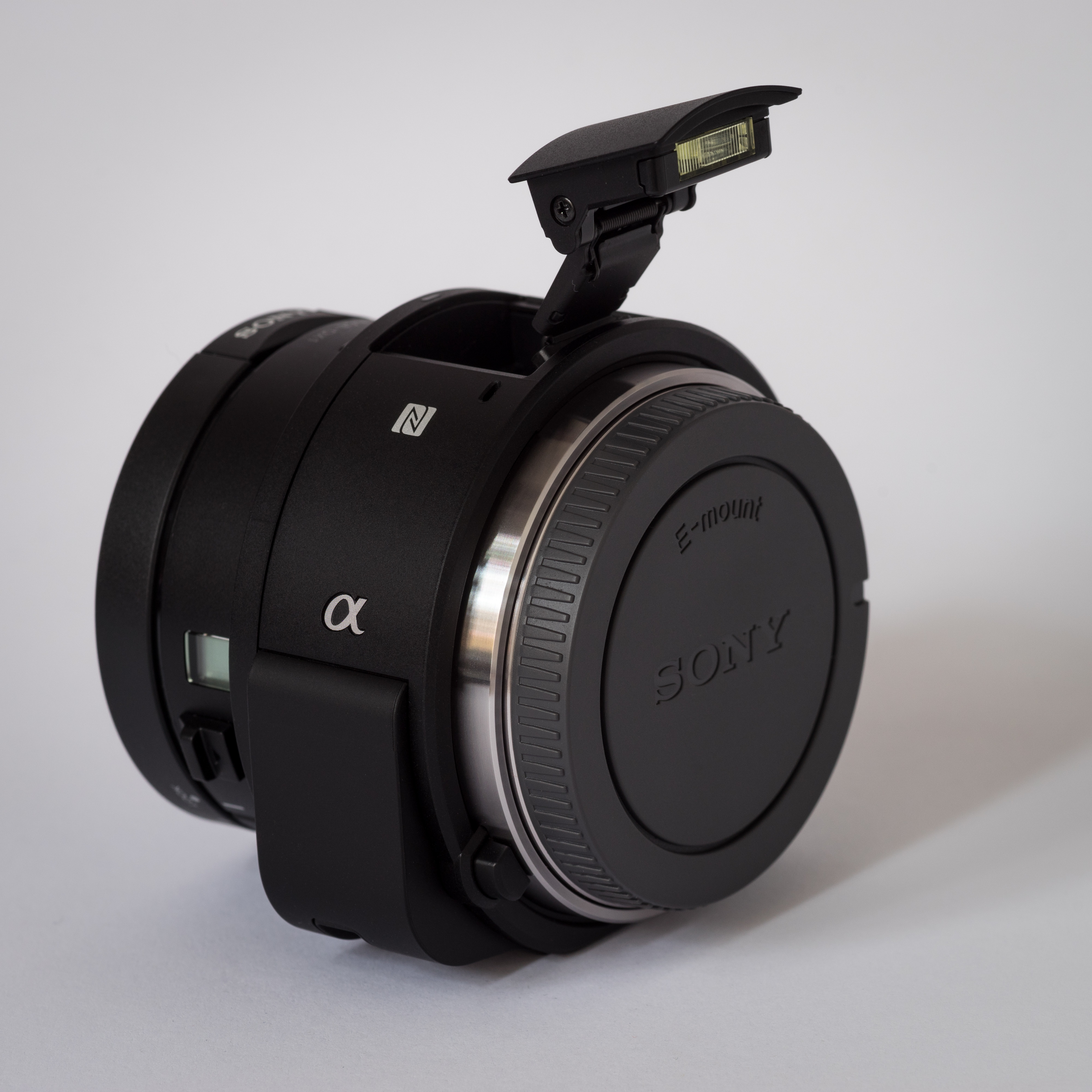 Sony Alpha ILCE QX1 APS C frame camera with body cap flash extended