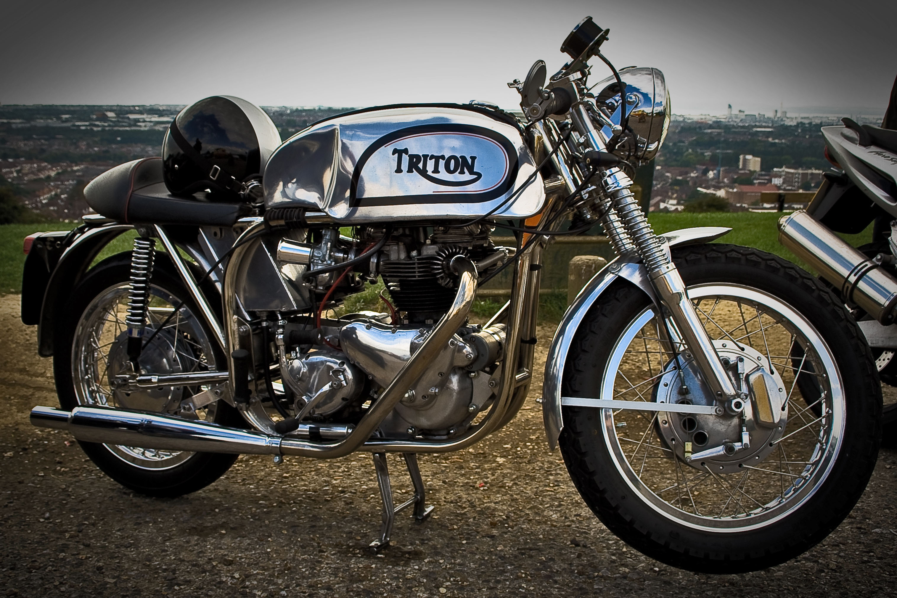 File triton norton triumph motorcycle with polished frame and tank