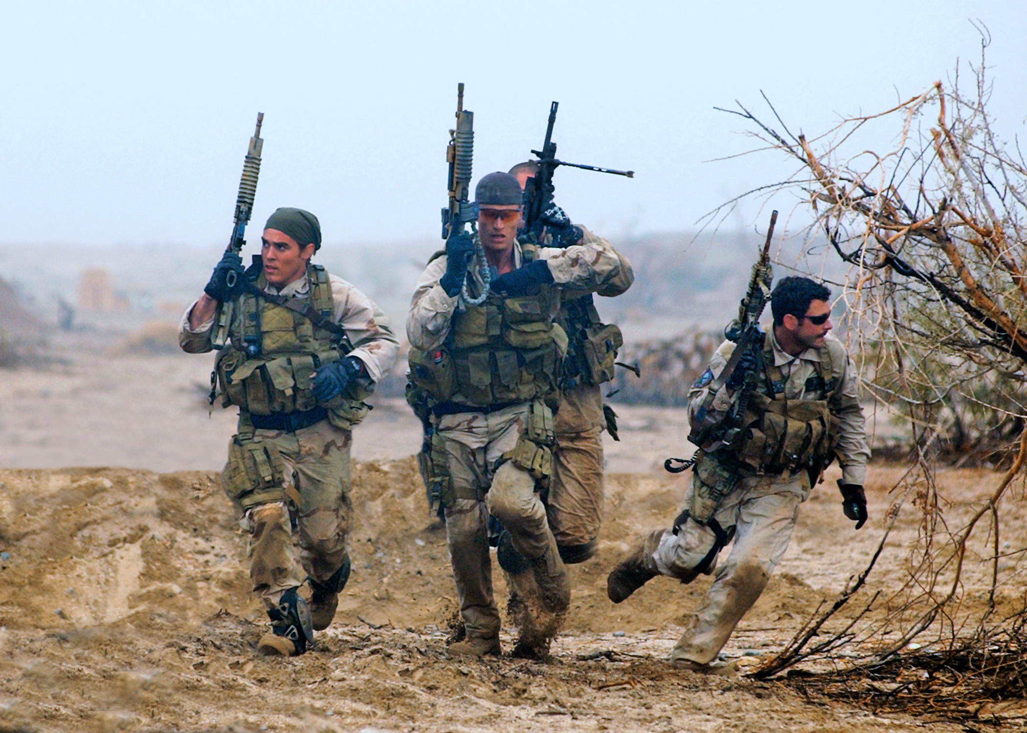 Members of a SEAL Team practice desert training exercises at