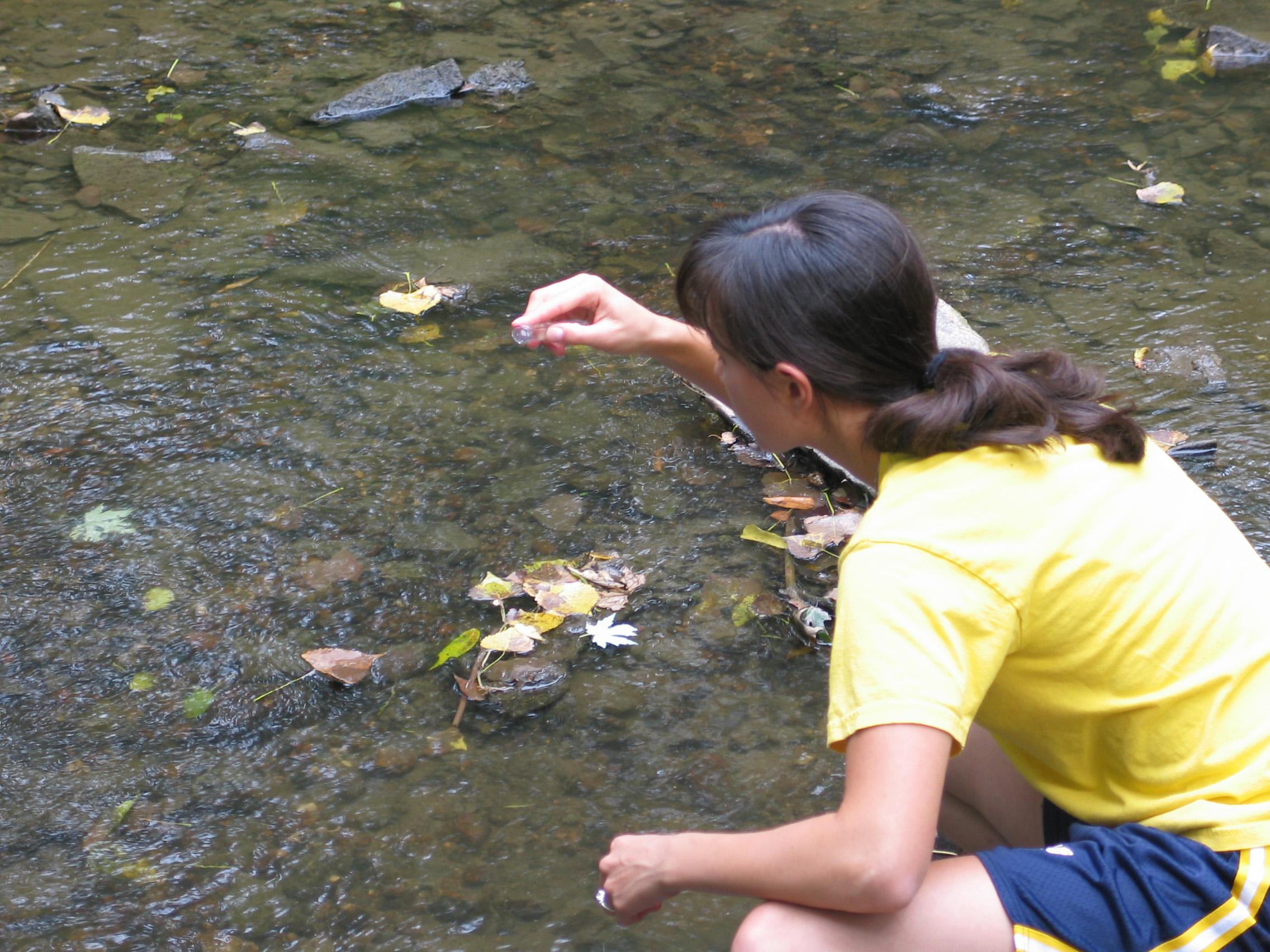 Environmental Scientist sampling water.