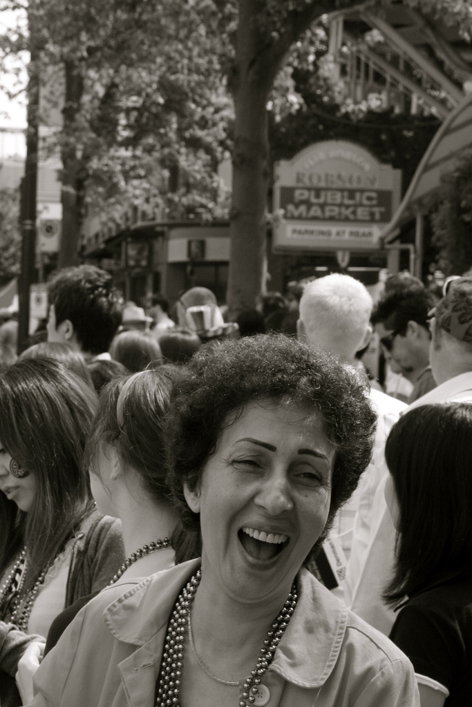"Woman laughing in crowd / ""Laughter"" photographer: Zakir Suleman on Wikimedia Commons"