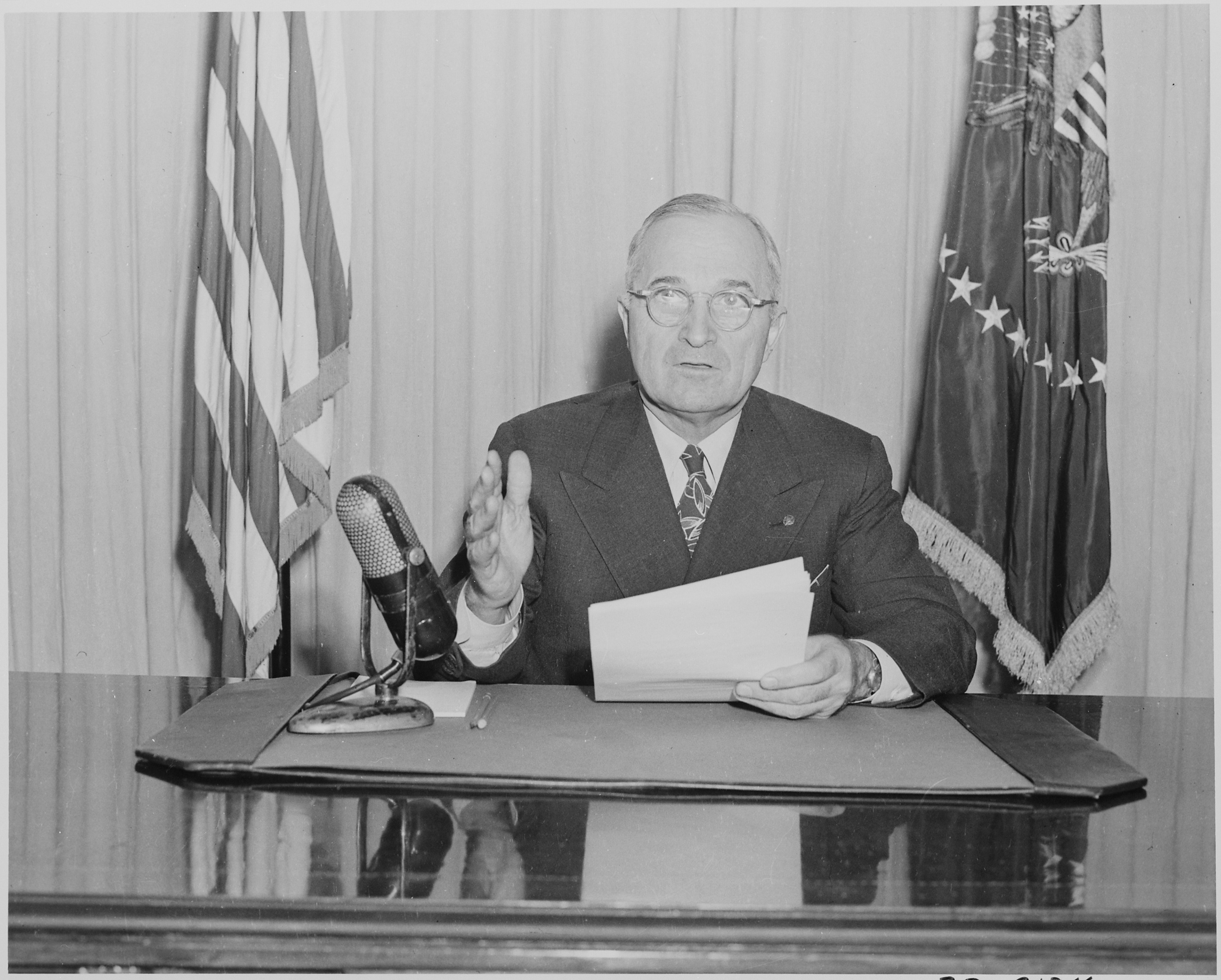 File:Photograph of President Truman delivering a radio speech to ...