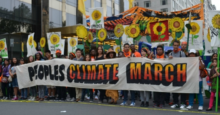 South Bend Voice - 2014 People's Climate March crowd with banner.jpg