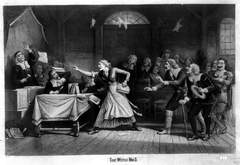 A black-and-white engraving of a witch trial in which an angry woman throws a book at her accusers.