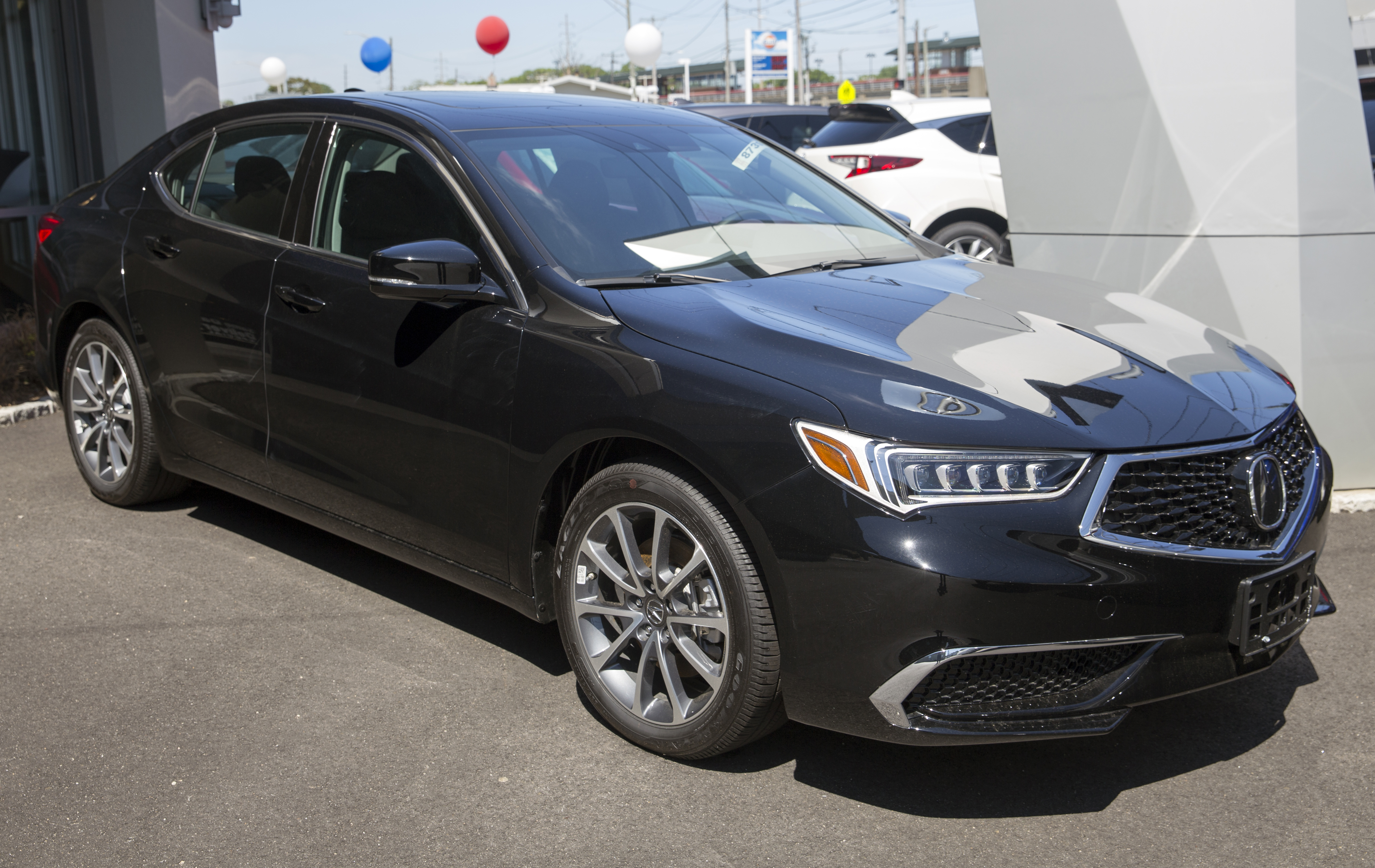 File20 Acura TLX 20.20 SH AWD in Crystal Black, front right.jpg ...