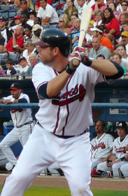 Brian McCann, dressed in the Atlanta Braves' home whites, stands ready at the plate