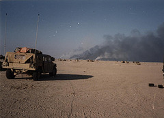 Destroyed Iraqi tanks burning at the Battle of Norfolk during the 1st Gulf War, February 1991.