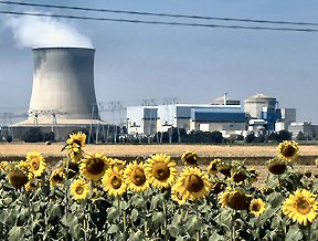 Nuclear power plant behind field of sunflowers