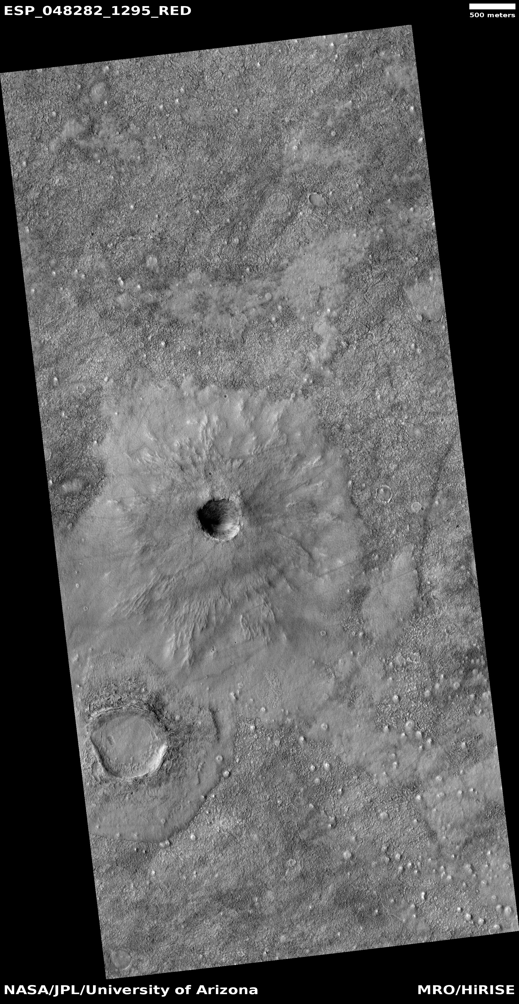 Unnamed crater with thin ejecta There are also many cones visible in the image.