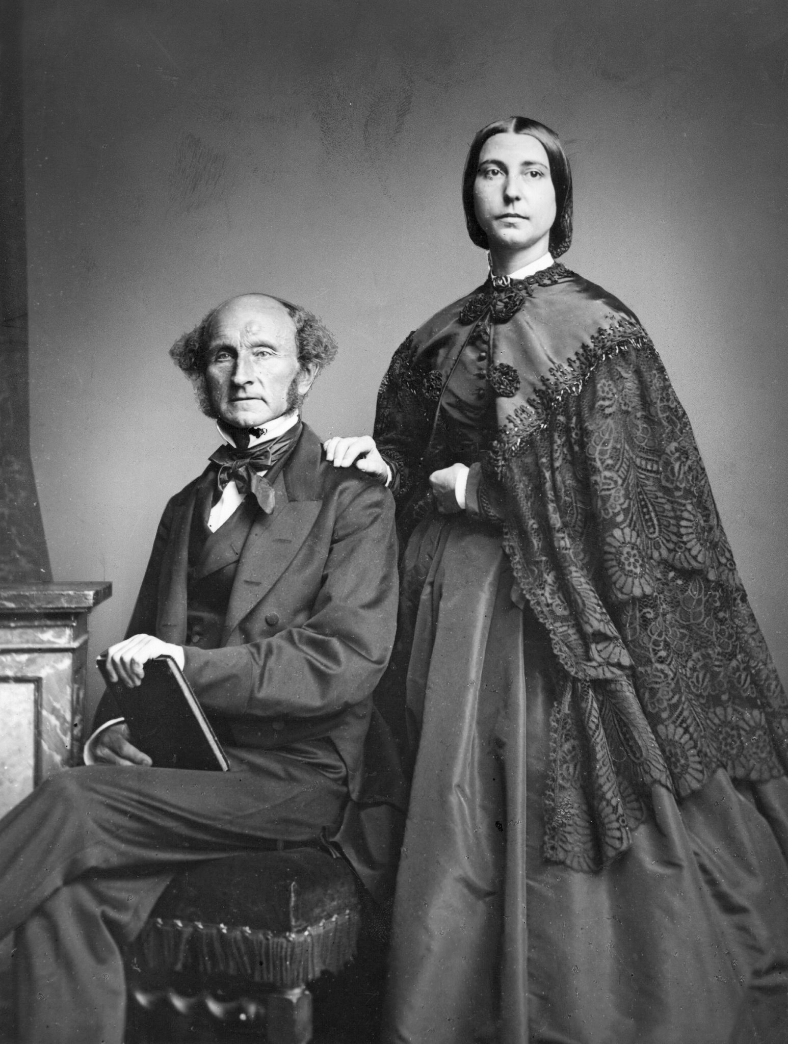 John Stuart Mill with Helen Taylor, the daughter of Mill's late wife and sometimes writing partner, Harriet Taylor, in 1858 (Wikimedia Commons)