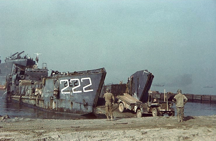 The U.S. Navy tank landing craft LCT-222 lands a U.S. Army Jeep on an Italian beach. LST-1 is in the background, at left.The Jeep has the serial Nr. 2039078. This view may have been taken during the Salerno landings, circa September 1943