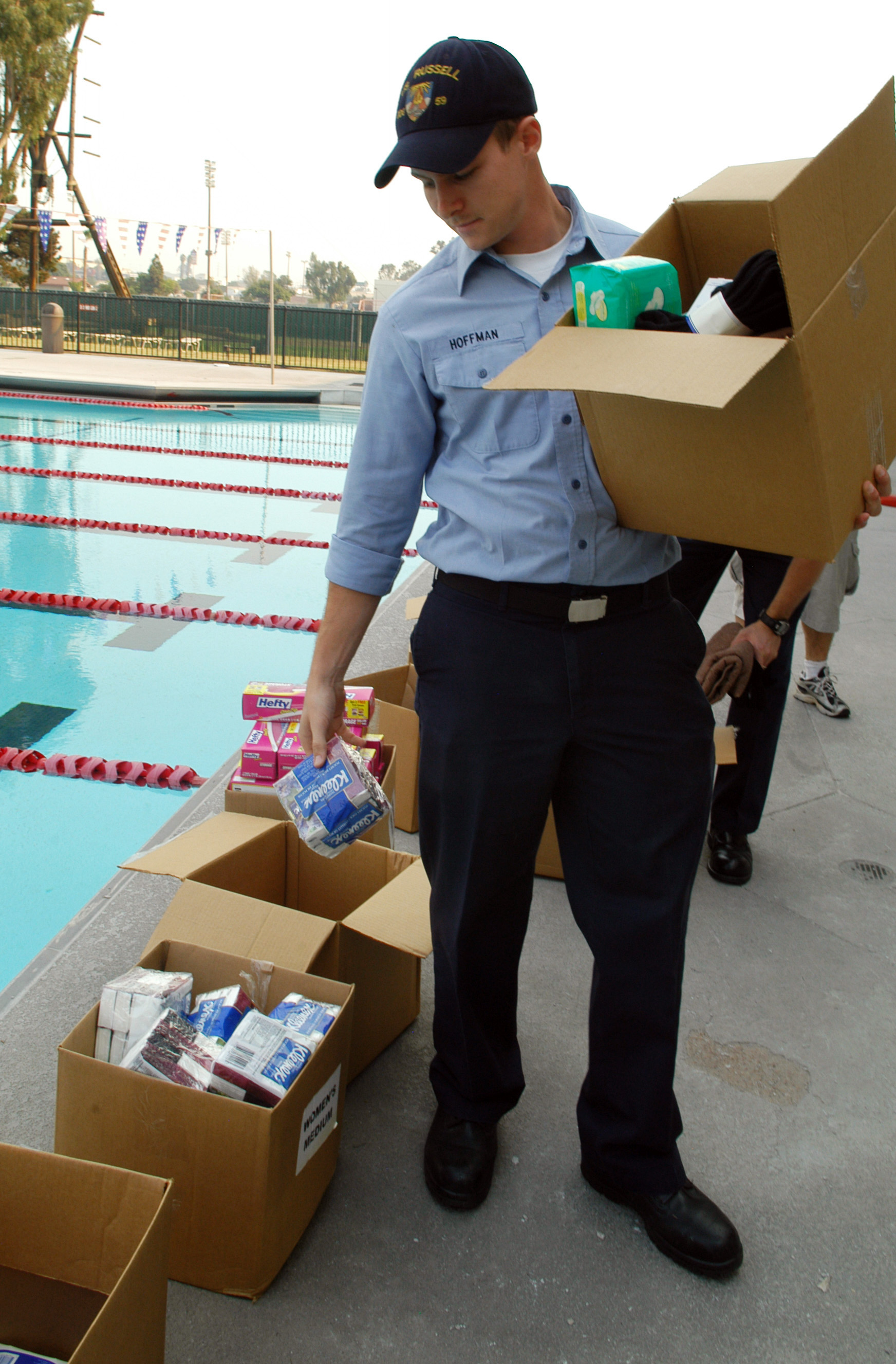 US Navy 071024-N-6652A-063 Fire Controlman 3rd Class Ken Hoffman, from USS Russell (DDG 59), helps put together care packages for San Diegans who were displaced from their homes due to the wildfires
