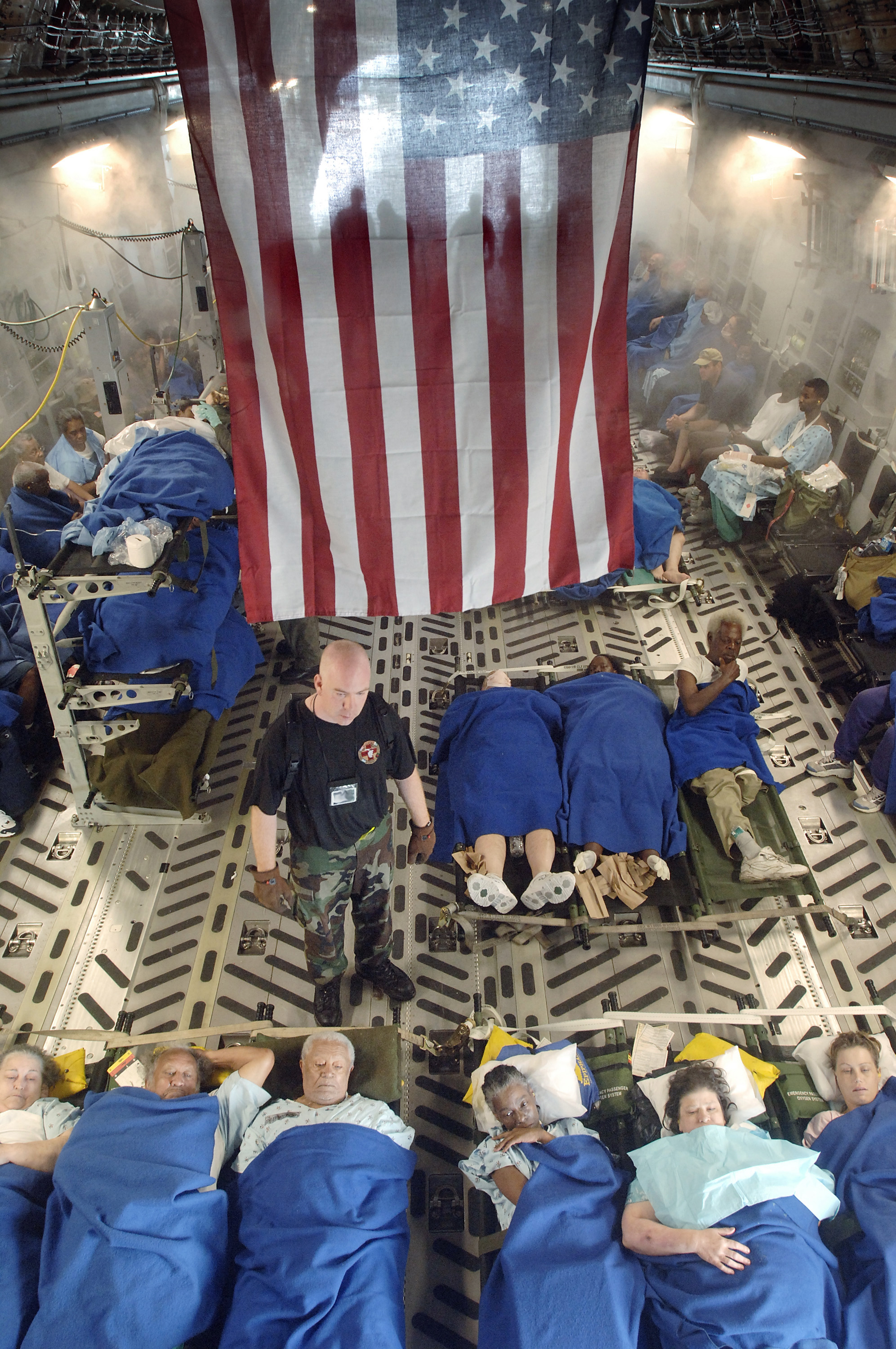 File:Air Force Flight Nurse caring for Hurricane Katrina victims.jpg ... Hurricanekatrina