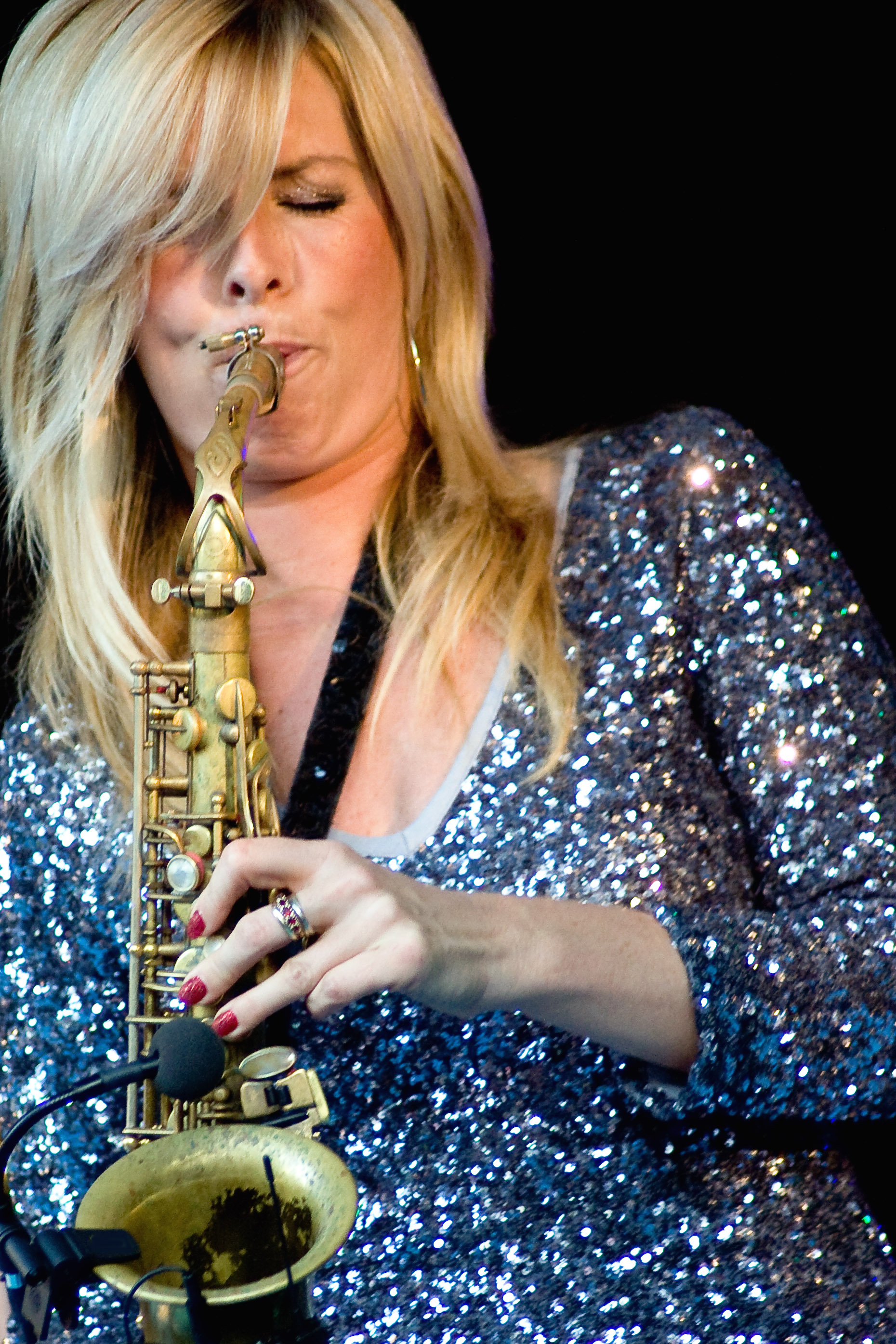 The 49-year old daughter of father Hans Dulfer and mother Inge Dulfer Candy Dulfer in 2018 photo. Candy Dulfer earned a  million dollar salary - leaving the net worth at 0.8 million in 2018